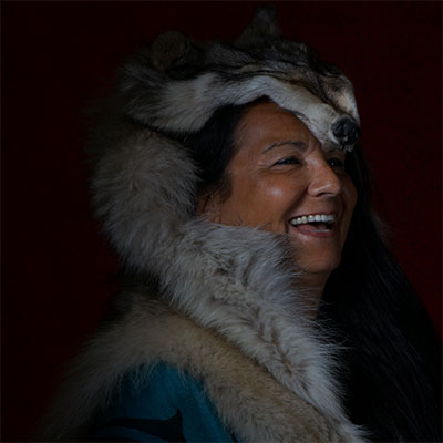 A photo of Leslie Williamson in traditional Wolf Clan garb