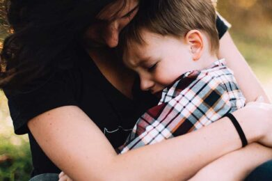 mother hugging young boy | Compassionate Parenting with Nonviolent Communication | photo by Kelli McClintock on Unsplash