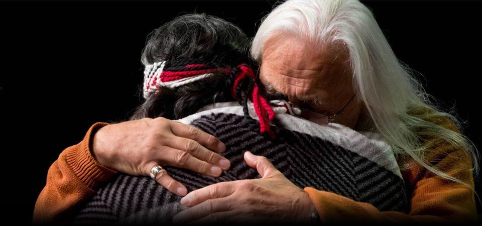 Two indigenous men hugging | Healing Trauma of Residential Schools with Nonviolent Communication