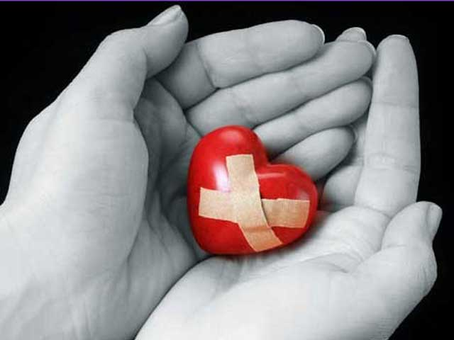 red heart with bandages held in hands | Healing from Past Trauma using Nonviolent Communication